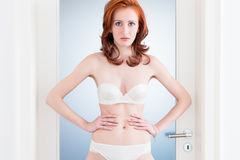 Bride in bridal lingerie standing in home Royalty Free Stock Image