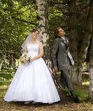 Bride with bridegroom. In the forest stock photography