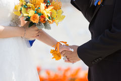Bride and bridegroom hand in hand. At wedding stock images