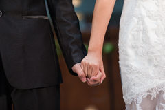 Bride and bridegroom hand in hand Royalty Free Stock Image