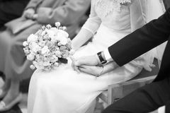 Bride and bridegroom in wedding marriage ceremony holding hands Stock Photo