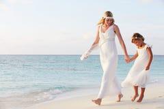 Bride With Bridesmaid At Beautiful Beach Wedding Stock Photography