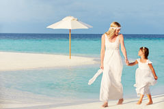 Bride With Bridesmaid At Beautiful Beach Wedding Royalty Free Stock Image