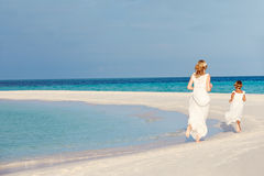 Bride With Bridesmaid At Beautiful Beach Wedding Stock Image