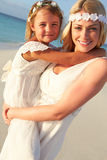 Bride With Bridesmaid At Beautiful Beach Wedding Stock Photos