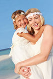 Bride With Bridesmaid At Beautiful Beach Wedding Stock Photography