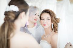 Bride and .bridesmaid stock photography