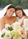 Bride With Bridesmaid In Marquee At Reception Royalty Free Stock Photography