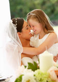Bride With Bridesmaid In Marquee At Reception Royalty Free Stock Photo