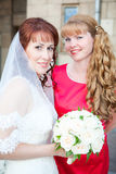 Bride with bridesmaid together Royalty Free Stock Photo