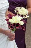 Bride and bridesmaid with wedding bouquets Stock Images