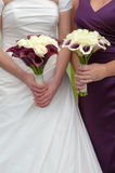 Bride and bridesmaid with wedding bouquets Royalty Free Stock Images