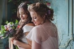 Bride and bridesmaids. Beautiful young women in dresses. And with bouquets of fresh flowers royalty free stock photos