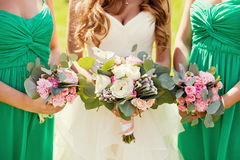 Bride and bridesmaids. With bouquets royalty free stock photo