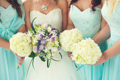 Bride and Bridesmaids bouquets. Close up of bride and bridesmaids bouquets royalty free stock image