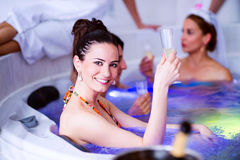 Bride and bridesmaids celebrating hen party in wellness center Royalty Free Stock Images