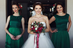 Bride with bridesmaids in green dresses Stock Photography