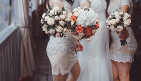 Bride and bridesmaids holding bouquets Royalty Free Stock Photography