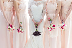 Bride and Bridesmaids. Holding wedding bouquet royalty free stock photos