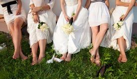 Bride and bridesmaids legs stock photos