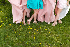 Bride and bridesmaids legs stock image