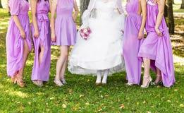Bride and bridesmaids legs Stock Photo