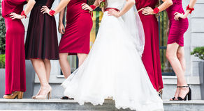 Bride with bridesmaids outdoors on the wedding day Stock Photography