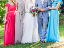 Bride with bridesmaids outdoors on the wedding day Stock Photos
