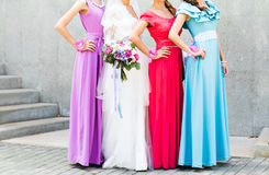 Bride with bridesmaids outdoors on the wedding day Royalty Free Stock Image