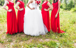 Bride with bridesmaids outdoors on the wedding day Royalty Free Stock Photos