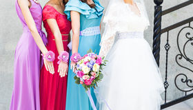 Bride with bridesmaids outdoors on the wedding day Royalty Free Stock Photo