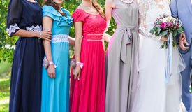 Bride with bridesmaids outdoors on the wedding day Stock Photo
