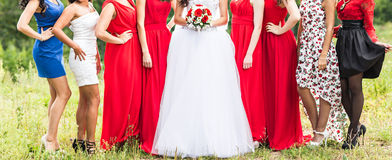 Bride with bridesmaids outdoors on the wedding day Royalty Free Stock Photography
