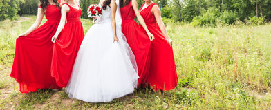 Bride with bridesmaids outdoors on the wedding day Royalty Free Stock Images