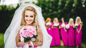 Bride with bridesmaids in a park. On the wedding day stock photos
