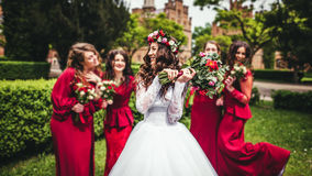 Bride with bridesmaids in a park. On the wedding day Stock Photography