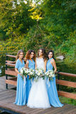 Bride with bridesmaids on the park. On the wedding day stock image