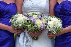 Bride and bridesmaids with wedding bouquets Stock Photos