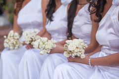 Bride and bridesmaids. Wedding photo of a bride with her bridesmaids, holding flower bouquets royalty free stock photography