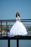 Bride on a bridge. Bride on the old bridge looks at cam royalty free stock photo