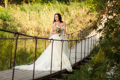 Bride on bridge Royalty Free Stock Images