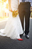 Bride and bridgroom walking in sunset Stock Images