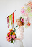 Bride with bright bouquet and flowers in her hair Royalty Free Stock Image