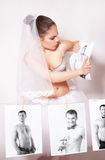 Bride broke a photo which shows the groom Royalty Free Stock Image