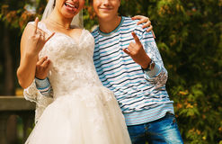 Bride with brother and sign of the horns Royalty Free Stock Photos