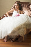 Bride with brown long hair sitting in chair Royalty Free Stock Images