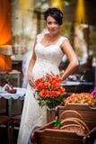 Bride, brunette, flowers Stock Photography