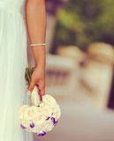 Bride bouquet with creamy bokeh. Bride with creamy bokeh holding the bouquet royalty free stock image