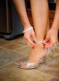 Bride buckling shoes royalty free stock image