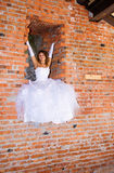 Bride in building site Stock Photo